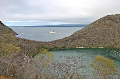 Galapagos - Isla Isabela - Darwin Lake  //  The cruise ship Galapagos Explorer II waits offshore while passengers take shore leave